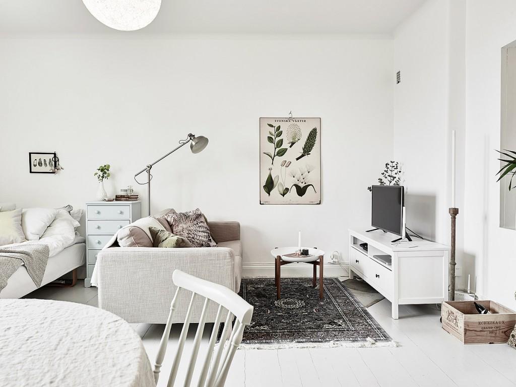 home-tour-appart-suedoise-salon-canapé-tapis-mademoiselle-claudine